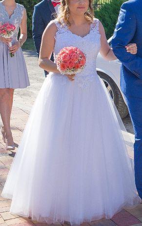 Suknia ślubna. Wiązana dlatego ciąża nie przeszkadza