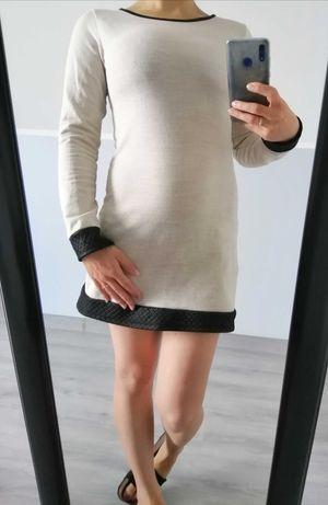 Sukienka beżowa ze skórzanymi wykończeniami