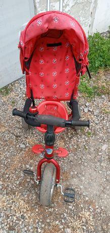 Детский велосипед- коляска.