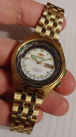 """Японские часы """"Orient"""" Japan с городами в жёлтом корпусе времён ссср."""