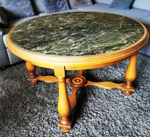 Stół okrągły z marmurowym blatem.