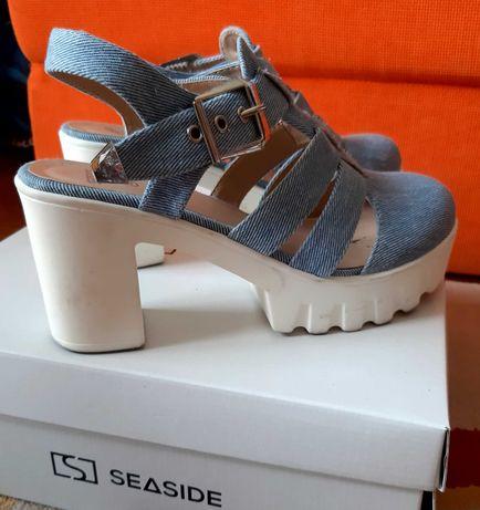 Sandalias e botas seaside como novas