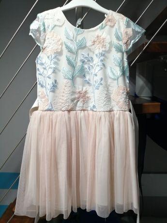 Sprzedam sukienkę rozm. 128/134
