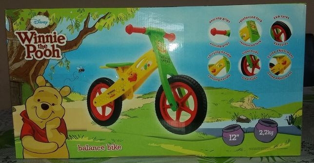 Nowy nieużywany drewniany rowerek biegowy Kubuś Puchatek lekki 2.2kg