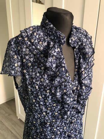 Koszula bluzeczka w kwiatuszki firmy flame rozmiar 40