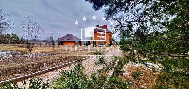 Продам качественный дом в пригороде Харькова