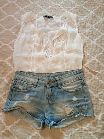 Короткие рваные джинсовые шорты с черепами
