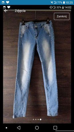 Nowe spodnie jeansy dżinsy moodo M 38