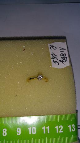 Pierścionek złoty z diamentami w cenie 1900 zł