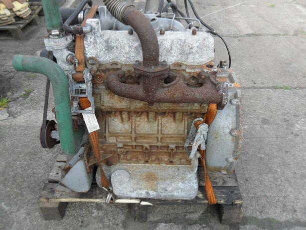 Silnik Kubota  4-cylindrowy diesel