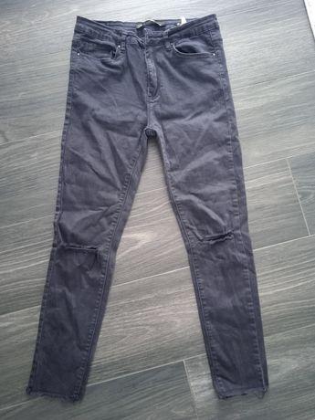Jeansy czarne przecięcia w kolanach