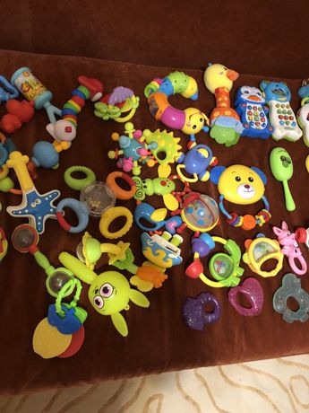 Погремушки, развиваюшие игрушки