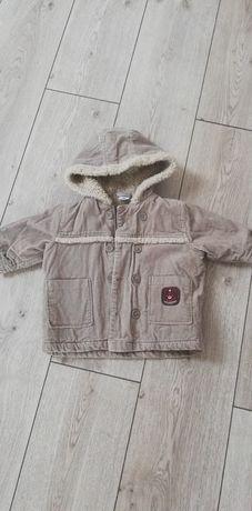 Тепла куртка 74р.