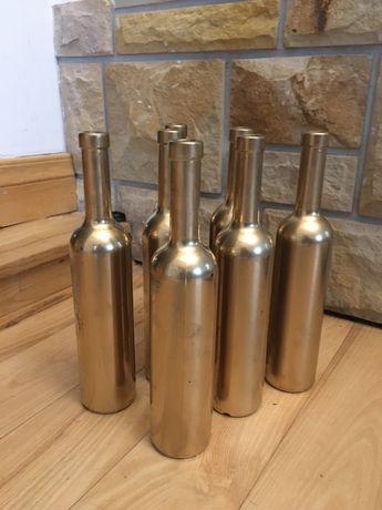 Sprzedam dekoracyjne butelki kolor złoty chrom-16 szt.