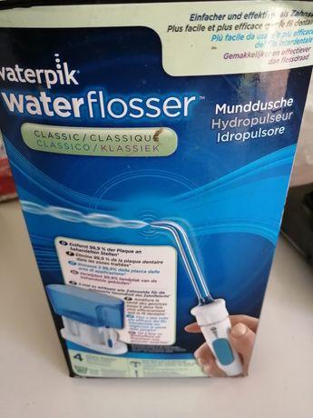 Máquina de limpar dentes.