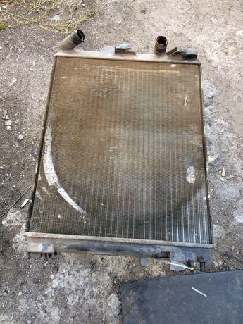 Радиатор дачия логан