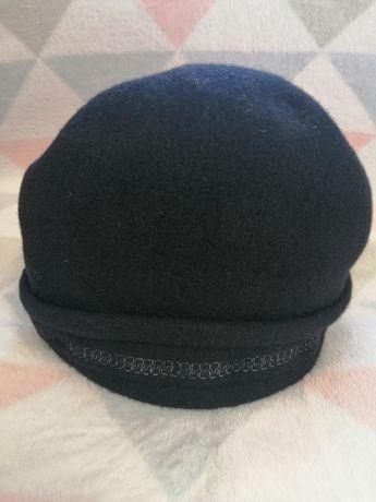 Отдам черную женскую шапку