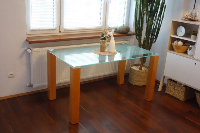 Stół Nova Meble- Szklany z nogami z litego drewna .Do salonu lub kuch