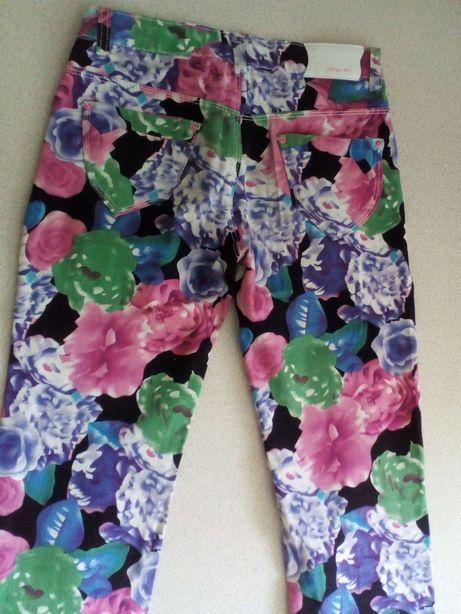 Jeansy w kwiaty jak nowe r. 158