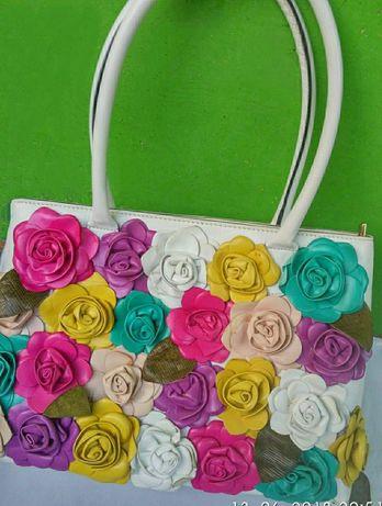 Эффектная женская кожаная сумка от итальянского люкс бренда FELLINI