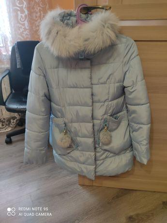 Продам зимову курточку на дівчинку