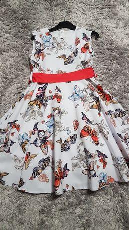 Śliczna sukienka na każdą okazje r. 146