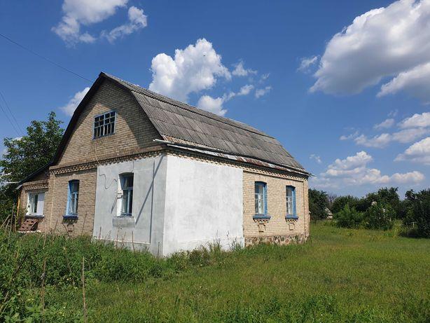 Добротный дом с большим участком