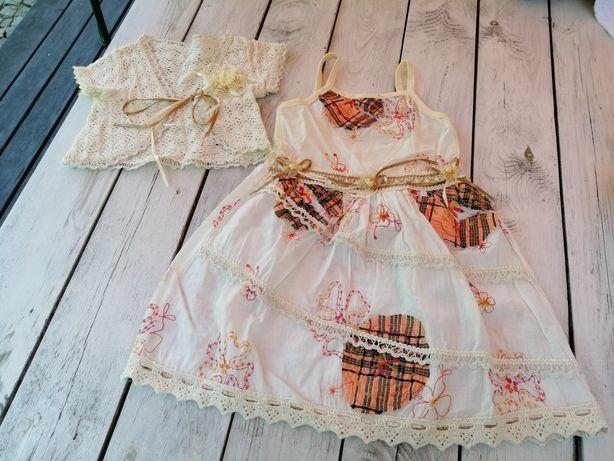 Dziecięca sukienka beżowo pomarańczowa z bolerkiem rozm. 98-104