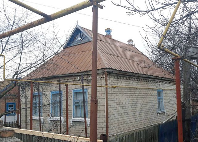 Продаётся кирпичный дом в г. Пологи