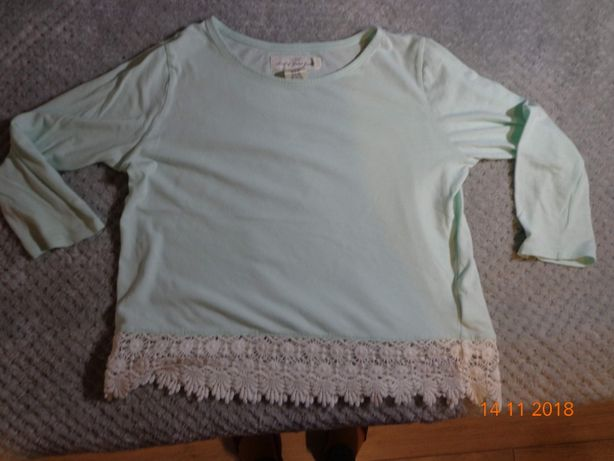 Miętowa bluzeczka z koronką H&M rozmiar 134/140
