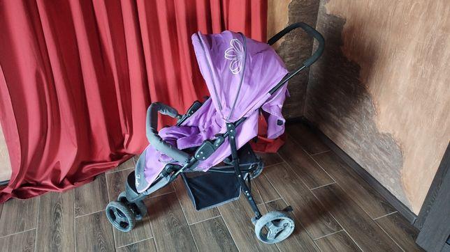 Трёхколесная прогулочная коляска