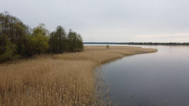 Działka 15ha z długą linią brzegową 550m - pod siedlisko nad jeziorem