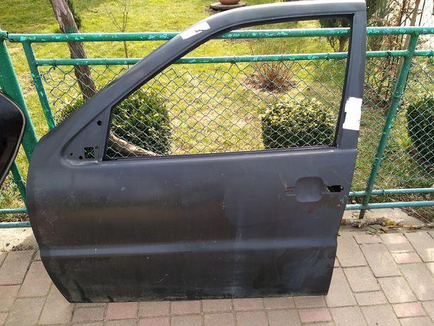 Дверка передня ліва Volkswagen Polo 2001р,6N4831055F