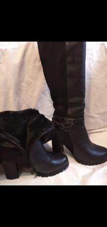 Зимові сапожки на каблуку