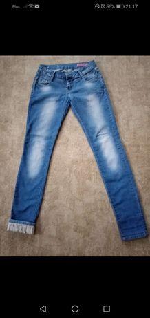 Spodnie jeansy rurki biodrówki podwijane