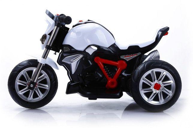 Детский мотоцикл на трех колесах,на электродвигателе