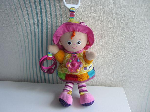Развивающая мягкая игрушка погремушка кукла Эмили Tomy Lamaze Ламазе