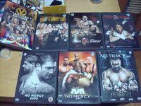 lote 14 dvds originais wwe wrestling