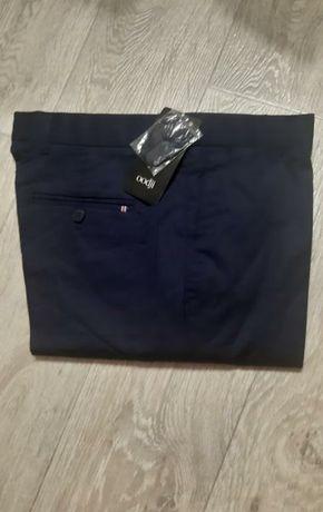 Чоловічі брюки нові