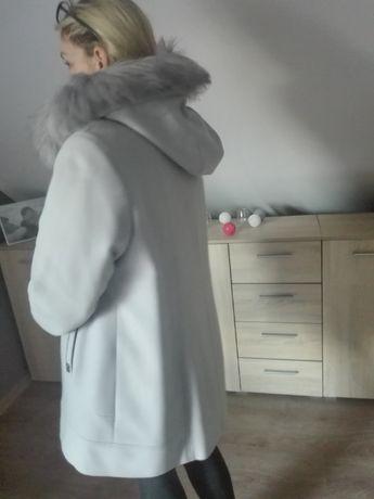 Elegancki damski płaszczyk