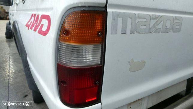 Farolim Esquerdo Mazda B-Serie (Un)