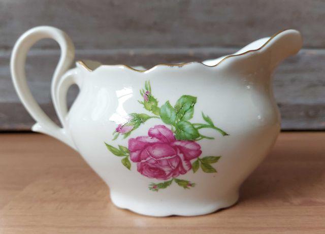 Piękny zabytkowy mlecznik z różą