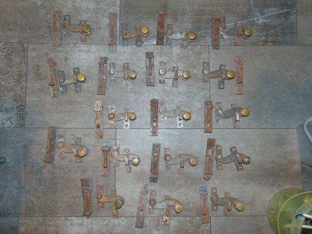 Przedwojenna mosiężna klamka,klamki,rygle do okna