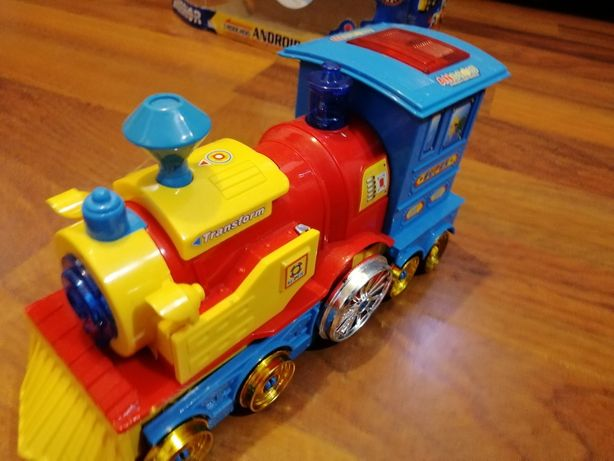 Pociąg transformer z dźwiękiem, sam jeździ.
