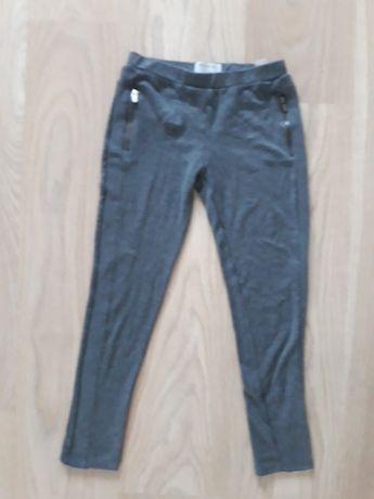 Sprzedam spodnie szare reserved 140