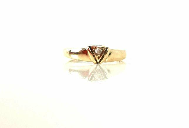 Złoty pierścionek z cyrkonią 1,23g 333 R14