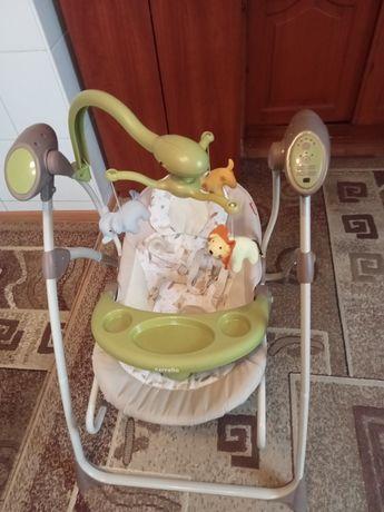 Музична колиска-гойдалка. Шизлонг для маленької дитини