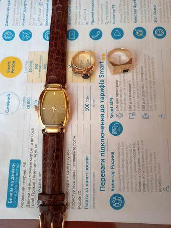 Часы золотые смарагд