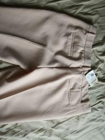 PROMOD różowe eleganckie spodnie nowe z metką r.42
