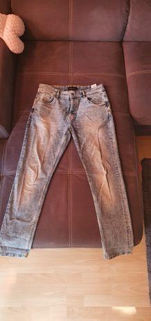 Nowe spodnie Reserved 32/32